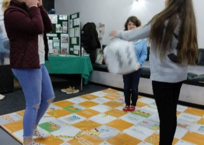 Down the snake in Eco Action food waste snakes and ladders