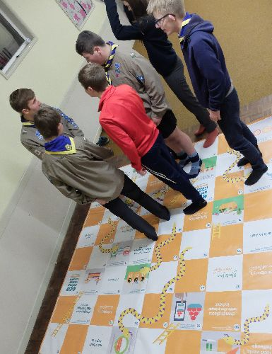 Scouts playing EcoAction food waste snakes and ladders